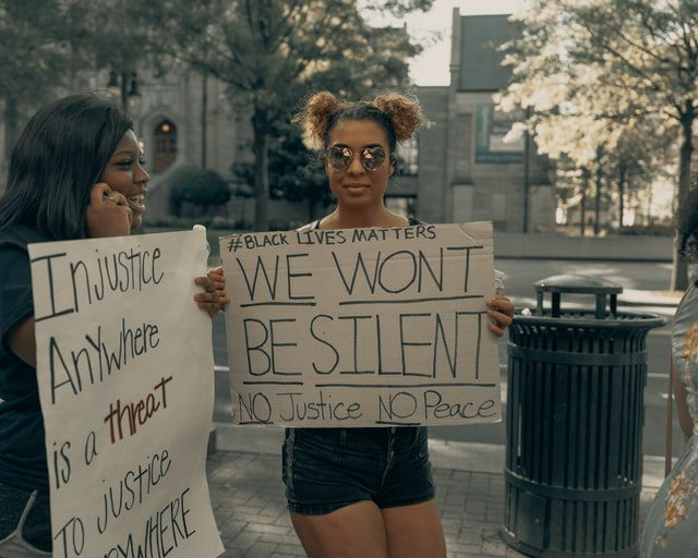 Two women holding Black Lives Matter signs